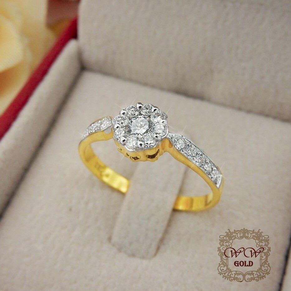 แหวนเพชรดีไซน์ดอกไม้ก้านเพชรโค้ง